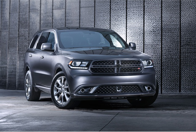 The automaker gave the new Durango a slimmer split-crosshair grille design and redesigned projector-beam headlamps with a raised front bumper. Photo courtesy Chrysler Group.