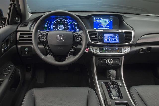 Inside, the 2014 Accord Hybrid features a number of safety functions, including the LaneWatch blind-spot monitoring system, lane departure warning, forward collision warning, and a multi-angle rearview camera with guide lines.