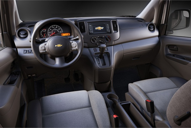 The automaker said a gray cloth interior is standard. The vehicle also features a fold down passenger seat with a seat back tray table; a center console with storage for file folders, a laptop, and more; and an upper dashboard mounted storage bin. Photo courtesy GM.