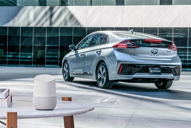 Photo of the Google Home, which utilizes Google Assistant features, and the 2017 Hyundai IONIQ Electric, courtesy of Hyundai.