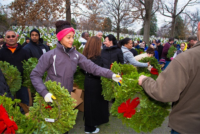 At Arlington National Cemetery, volunteers from trucking companies, youth groups, veterans organizations, active-duty military and the general public placed the wreaths at grave sites.