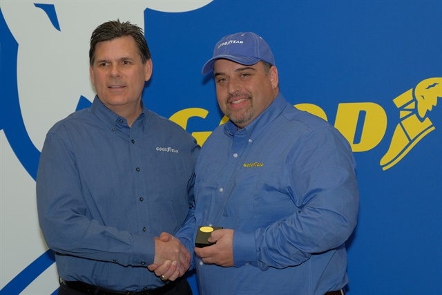 <p><strong>Gary Medalis (left), Goodyear marketing director, congratulates the 2018 Highway Hero Award winner, Frank Vieira of Hamilton, Ontario, Canada. </strong><em>Photo: Jim Park</em><strong><br /></strong></p>