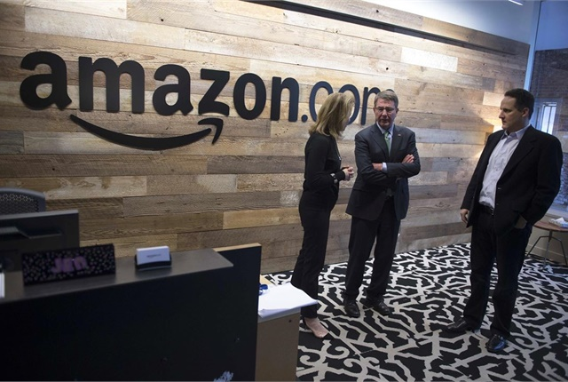 Former Defense Secretary Ash Carter, center, tours Amazon headquarters in Seattle. DoD photo by Navy Petty Officer 1st Class Tim D. Godbee.