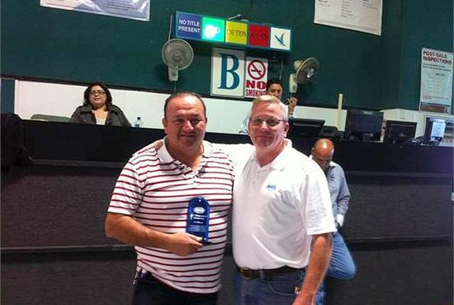 Photo of ARI's Jim Jackson (right) with Art Mecias courtesy of ARI.