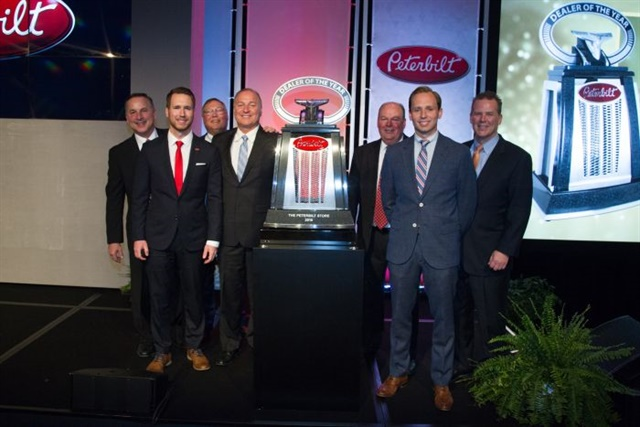 <p><strong>The Peterbilt Store's president and CEO John Ascott accepted the North American Dealer of the year with his two sons Jeff and Greg Arscott.</strong> <em>Photos: Peterbilt</em></p>
