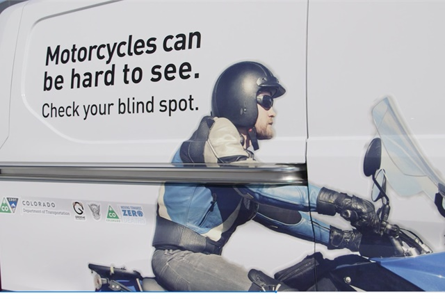 The vehicle wrap on a Groove Auto fleet vehicle reminds motorists to watch for motorcyclists. Photo courtesy of the Colorado Department of Transportation.