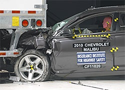 The underride guard on the Manac trailer, above, was the only one of eight tested to prevent underride in a 30% overlap crash. The performance of the Utility trailer, below, was more typical. IIHS photos.