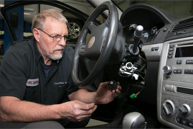 A technician replaces a faulty ignition switch on a Chevrolet Cobalt back in April. Photo courtesy of General Motors.