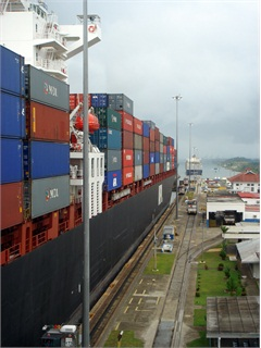 Container ship going through the Panama Canal. In a couple of years, larger ships will be able to go through the canal, which could change port dynamics in the U.S.