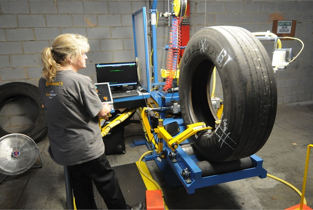 <p>Dawn Watkins inspects a tire at newly opened DLS Retreading in Fort Mill, S.C.</p>