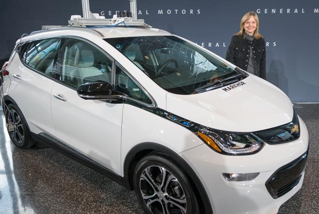 General Motors CEO Mary Barra with a GM autonomous vehicle. Photo by Steve Fecht for GM.