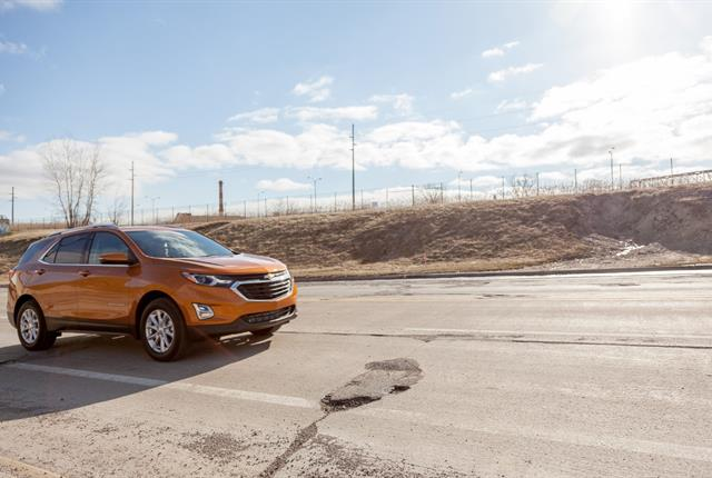 Melting ice and snow can create rough roads and potholes, which can damage vehicles. Photo courtesy of Chevrolet.