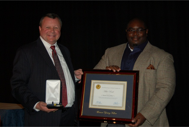 Jack Neshe (left), NAAA president, presents Mike Reid with the 2014 Warren Young, Sr. Fellowship.