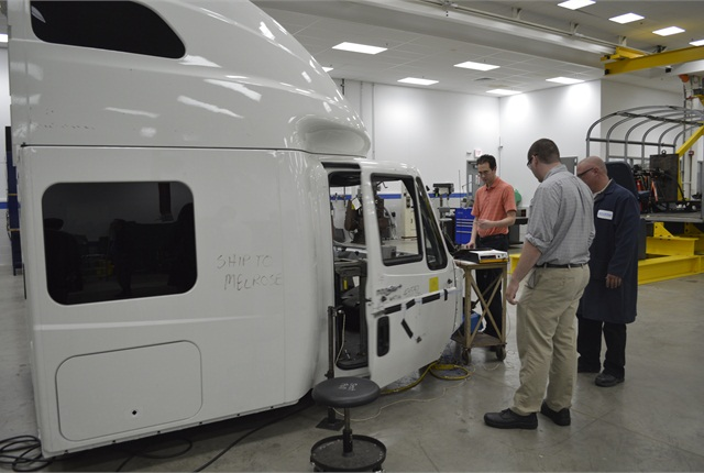 Employees at Navistar's Melrose Park location conduct many experiments and tests like pictured above where they are testing out slamming a door.