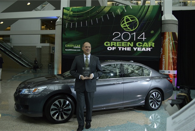 Michael Accavitti, senior vice president at American Honda, showing the 2014 Green Car of the Year Award for the 2014 Accord. Photo by Joanne Tucker.
