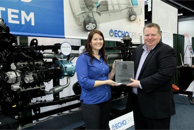 Amy Dobrikova, VP sales and business development, Echo Automotive, accepts ward from Steve Carey, executive director, NTEA.
