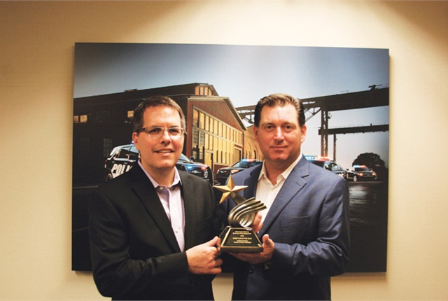 Photo of Fritz Ahadi (left) and Robert Brown, Jr. by Automotive Fleet.