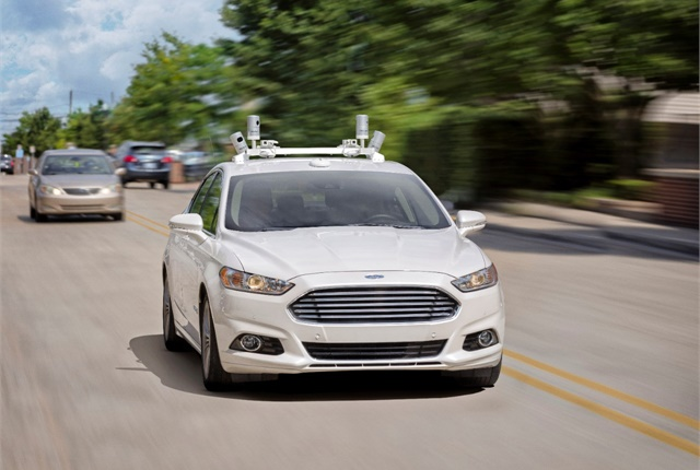 A Ford fully autonomous Fusion Hybrid research vehicle navigates the streets of Dearborn, Mich. Photo courtesy of Ford.