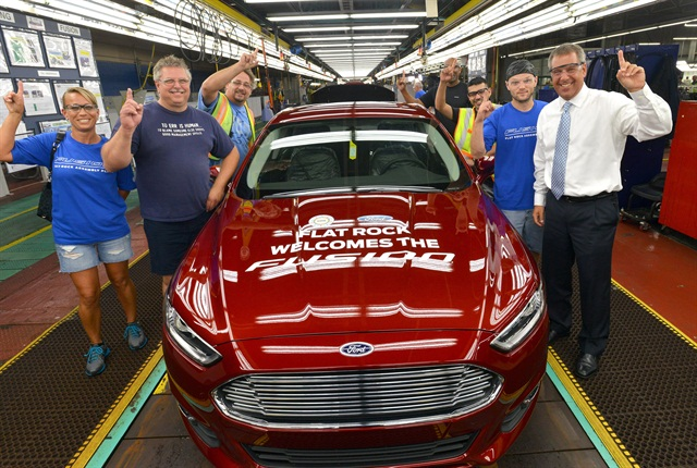 Joe Hinrichs, Ford President of the Americas, celebrates with team members during the Fusion Job One celebration event at Flat Rock Assembly Plant. Photo courtesy Ford.