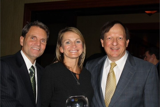 (l. to r.) Paul Seger, GE Capital Fleet; Julie Picard, Manheim Seattle; and Dennis Worthy, Manheim Milwaukee