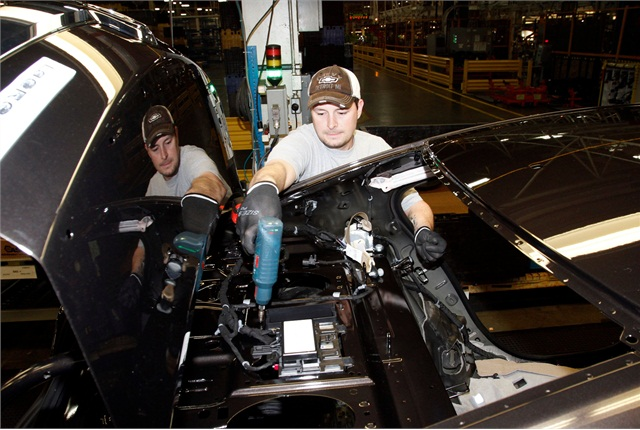 <p>Scott Hayes secures the battery in a Chevrolet Malibu Hybrid at the General Motors Fairfax Assembly and Stamping Plant Monday, January 28, 2013 in Kansas City, Kansas. The Fairfax plant produces the Buick LaCrosse and the Malibu. Photo courtesy GM.</p>