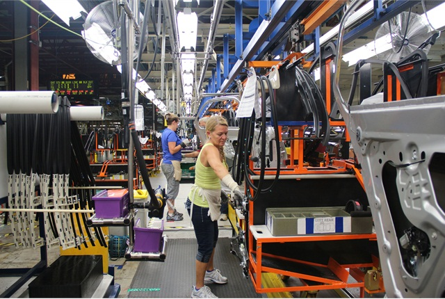 Employees at the Spring Hill, Tenn., plant work on doors on the Chevrolet Equinox. Photo courtesy GM.