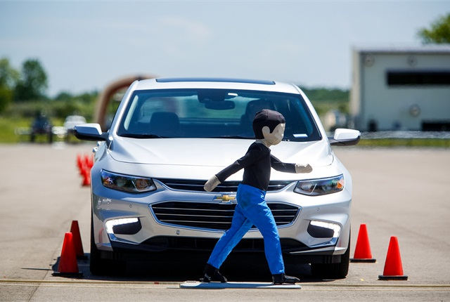 Front pedestrian braking, a new active safety technology available on the 2016 Chevrolet Malibu and 2016 Cadillac CT6, is one of many safety features tested at General Motors' new Active Safety Test Area at the Milford Proving Ground in Milford, Mich. Photo by Jeffrey Sauger for General Motors.