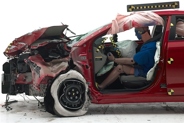 Photo of small overlap front driver side crash test courtesy of IIHS.