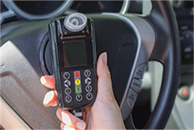 An alcohol ignition interlock is a breath-test device connected to a vehicle's ignition. Photo courtesy of CDC.