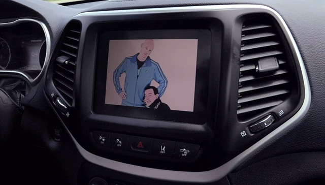 Screen capture of Miller (left) Valasek (right) on the screen from Wired's car hacking video.