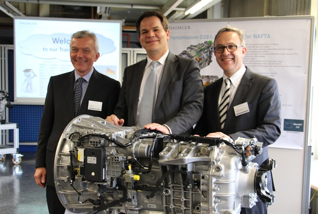 Daimler Trucks officials (from left) Ehrhard Thiel, manager for Gaggenau Powertrain Production; Frank Reintjes, head of Global Powertrain, Procurement and Manufacturing Engineering; and Matthias Jurytko, Gaggenau plant manager, with the new DT12 transmission where it is being assembled in Gaggenau, Germany. (Photo by Evan Lockridge)