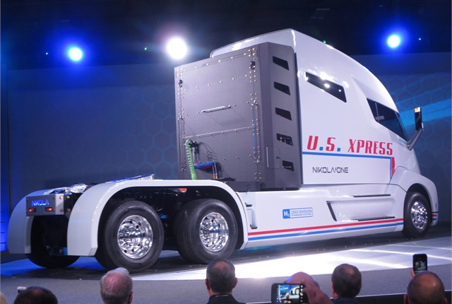 <p><strong>A wrap was removed and the Nikola One prototype revolved before the enthusiastic audience at the Dec. 1 unveiling. Liquified hydrogen is stored in bottles behind the long sleeper-cab. <em>Photos: Tom Berg </em></strong></p>