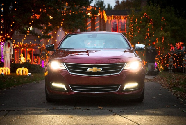 The 2014 Chevy Impala features HID headlamps. Photo credit: GM