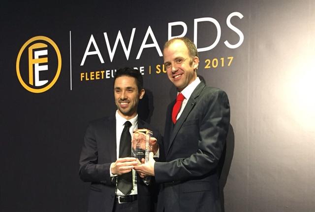 (From l. to r.) Davide Ghione, head of enterprise sales, Tesla. and Hamish Phillips, enterprise sales manager, Tesla, accepted the International Fleet Industry Award on behalf of Tesla.