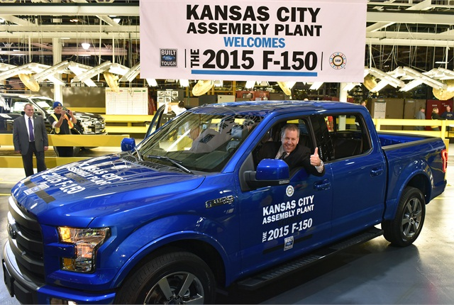 Joe Hinrichs, Ford's president of the Americas, drives the first 2015 F-150 built in Kansas City. Photo courtesy of Ford.