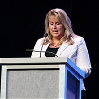 Kari Baylor, vice president, Baylor Trucking, accepts TCA Past Chairmen's Award on behalf of her father. Photo: Jim Beach