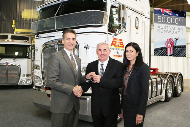 Mike Dozier (left), Managing Director, PACCAR Australia, presents the keys of the 50,000th Australian Built Kenworth to Peter Rodney (center), Managing Director of Rodney's Transport Service (RTS), and his wife – Shanelle, at the Kenworth Australia factory