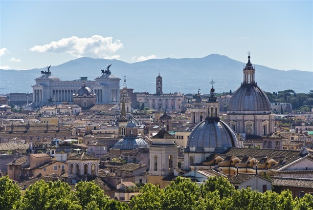 Photo of the Rome skyline courtesy of Bert Kaufmann via Wikimedia Commons.