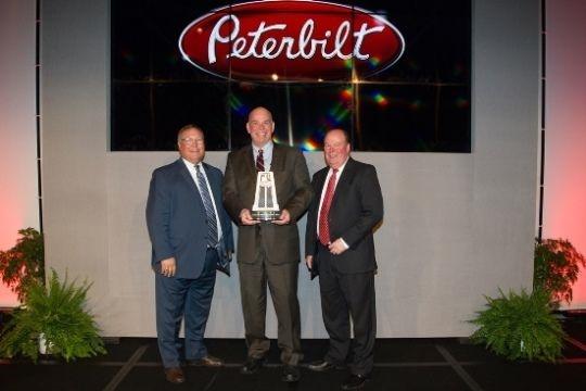 <p><strong>Doug Danylchuk, dealer principal of Peterbilt Manitoba, accepted the award at Peterbilt's annual Dealer Meeting.</strong></p>