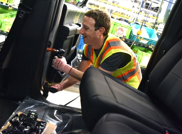 Facebook CEO Mark Zuckerberg works on the F-150 assembly line during a visit to Ford's Dearborn Truck Plant. Photo by: Sam VarnHagen