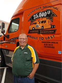 Michael Darras, a 23-year Schneider driver who's covered 3 million safe miles, was assigned to the specially decorated Freightliner Cascadia, painted in the carrier's traditional high-visibility orange. His shirt's green-and-gold colors appear to honor an even older Green Bay organization, the Packers of the National Football League.
