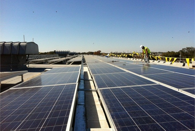 <p>When complete in February, a total of 1,392 solar panels will be installed in the three-array system, which covers about 50,000 square feet. <em>Photo courtesy of ESA Renewables.</em></p>
