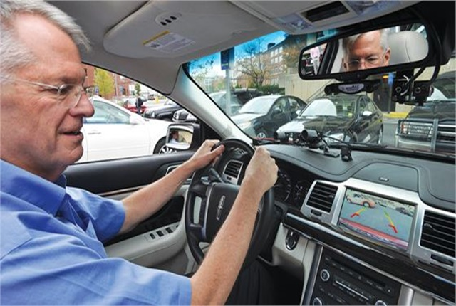 A driver uses a parking assist system to parallel park. Photo courtesy of IIHS.