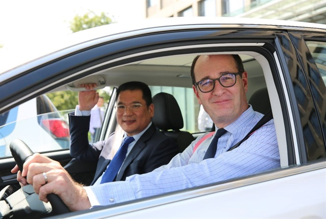 Peter Fleet (right), group vice president and president, Asia Pacific, Ford Motor Company, and Mr. Jin Zheyong, chairman and president, Anhui Zotye Automobile Co., Ltd. Photo: Ford