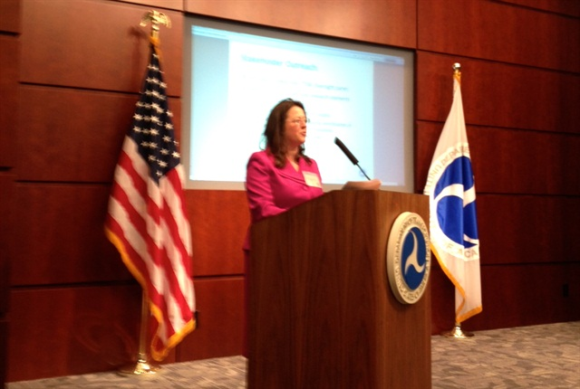Caitlin Rayman, director of the FHWA Office of Freight Management and Operations speaking to those attending the first public session of the agency's truck size and weight study.