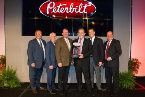 """<p><strong>Rush Enterprises' chairman, CEOand president W.M. """"Rusty"""" Rush, senior vice president and COOMichael J. McRoberts, senior vice present – Peterbilt Dealerships Corey H. Lowe and senior vice president of Retail Sales James E. Thor accepted the award during Peterbilt's annual Dealer Meeting.</strong></p>"""