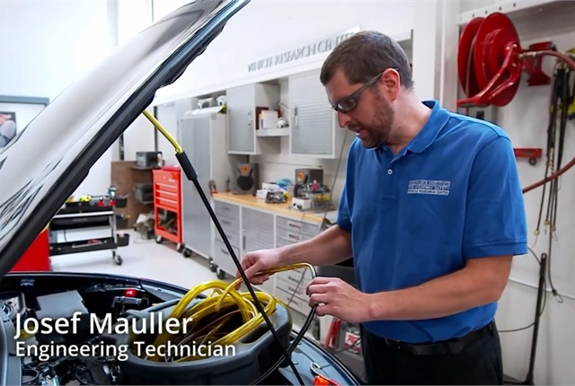 In a scene in IIHS' new video, Josef Mauller prepares a vehicle for a crash test at the IIHS Vehicle Research Center.
