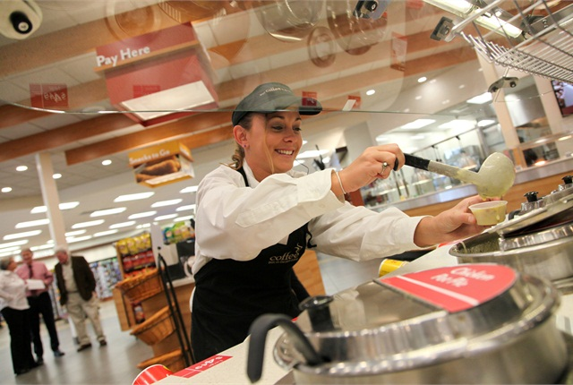 Pilot Travel Center employee Erica Peacock pours a sample of broccoli cheddar soup from the soup bar at the newly opened Pilot Travel Center in St. Marys, Ga., on March 21.