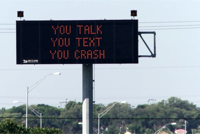 The latest addition to Texas' efforts to prevent distracted driving is a one-hour video course. In September, the video will become required viewing for driving skills exam applicants 18 and older. The state has also sought to raise awareness of the problem through signage, as shown here. Photo courtesy of the Texas Department of Transportation.