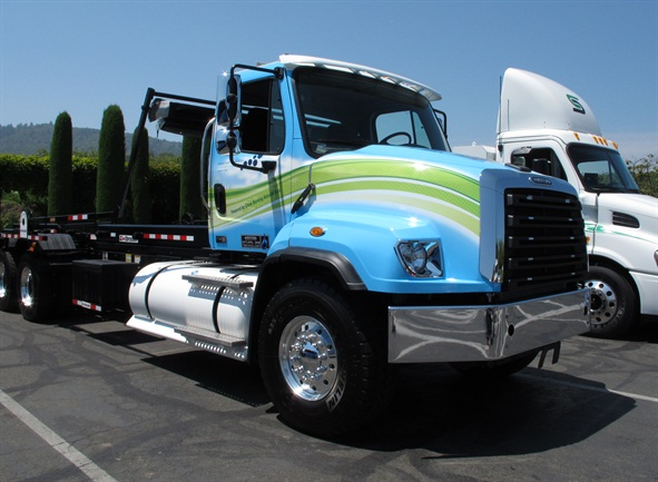 Freightliner's 114SD set-back proof-of-concept truck, equipped with an ISX12 G, set up for a roll-off operation